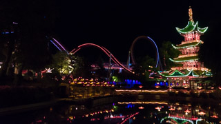 Dæmonen, roller coaster at the Tivoli Gardens amusement park by night, Copenhagen, Denmark